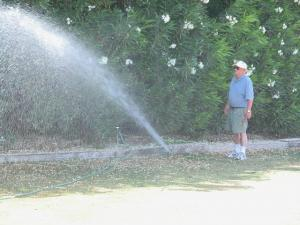 a sprinkler repair tech uses an above ground line to test temporary head placement